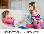 angry young woman with child on ... | Shutterstock . vector #260979944