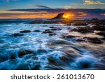 Waves And Rocks At Sunset  At...