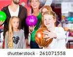 parents playing with children... | Shutterstock . vector #261071558