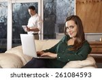 coupe at home  woman using...   Shutterstock . vector #261084593