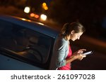 pretty  female driver using her ... | Shutterstock . vector #261097028