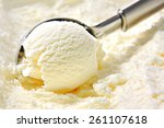 Stock photo vanilla ice cream scoop scooped out of a container with a utensil 261107618