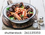 spicy seafood soup with mussels ... | Shutterstock . vector #261135353