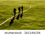 Silhouette Of A Group Of Peopl...