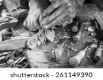 Hand Of Carver Carving Wood In...