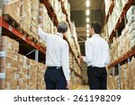 two managers workers in... | Shutterstock . vector #261198209