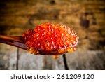 fresh red caviar in a wooden...   Shutterstock . vector #261209120