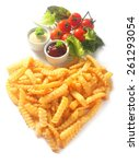 Small photo of Crispy golden crinkle cut French fries arranged in a heart shape symbolic of love, romance or Valentines Day with with dips, tomatoes herbs and lettuce, high angle on white