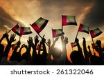 group of people waving flag of... | Shutterstock . vector #261322046