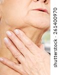 close up on older woman's hand... | Shutterstock . vector #261400970