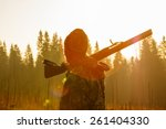 silhouetted of a hunter with... | Shutterstock . vector #261404330