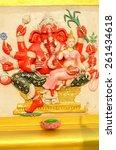 Small photo of beautiful Hindu god Ganesh on the wall