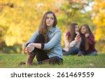 Stock photo caucasian teenager wondering about girls talking behind her 261469559