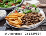 greek gyros with fries and salad | Shutterstock . vector #261539594