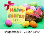 easter greeting card with eggs... | Shutterstock . vector #261544340