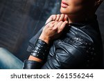 stylish girl in black leather... | Shutterstock . vector #261556244
