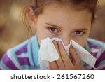 cute little girl blowing her... | Shutterstock . vector #261567260