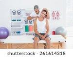 doctor examining his patient... | Shutterstock . vector #261614318