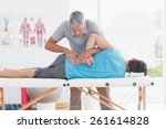 doctor examining man back in... | Shutterstock . vector #261614828