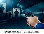 police officer holding a gun at ... | Shutterstock . vector #261620288