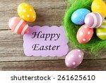 easter eggs in nest on grey...   Shutterstock . vector #261625610