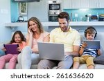 happy family on the couch... | Shutterstock . vector #261636620