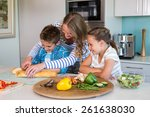 happy family preparing lunch... | Shutterstock . vector #261638030