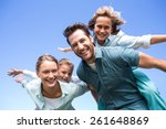 happy parents with their... | Shutterstock . vector #261648869
