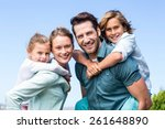 happy parents with their... | Shutterstock . vector #261648890