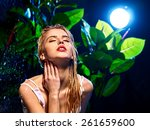 wet woman in jungle with water... | Shutterstock . vector #261659600