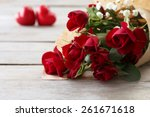Red Roses Wrapped In Paper Wit...