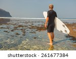 surfer with surfboard on... | Shutterstock . vector #261677384