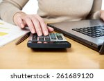 female hand using calculator | Shutterstock . vector #261689120