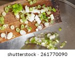 adding cut leek to the cooking... | Shutterstock . vector #261770090