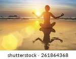 silhouette of yoga woman on sea ... | Shutterstock . vector #261864368