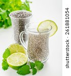 Small photo of Chia seeds drink with water in transparent glass with lime and lemon balm. selective Focus