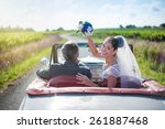 a newlywed couple is driving a... | Shutterstock . vector #261887468