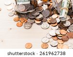 saving money into glass jar for ... | Shutterstock . vector #261962738