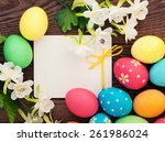 easter eggs on meadow with... | Shutterstock . vector #261986024
