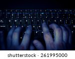 hands typing on keyboard in...