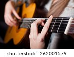 woman playing acoustic guitar | Shutterstock . vector #262001579