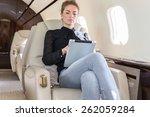 woman in corporate jet looking... | Shutterstock . vector #262059284