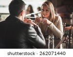 young couple at the bar having... | Shutterstock . vector #262071440