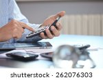 businessman with calculator | Shutterstock . vector #262076303