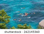 the group of people snorkeling... | Shutterstock . vector #262145360