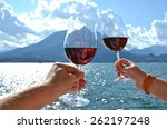two wineglasses in the hands.... | Shutterstock . vector #262197248