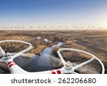 a small quadcopter drone flying ... | Shutterstock . vector #262206680