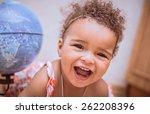 happy mixed race toddler girl  | Shutterstock . vector #262208396