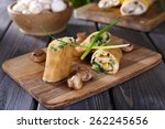 pancakes with creamy mushrooms... | Shutterstock . vector #262245656