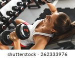 woman lifting weights and... | Shutterstock . vector #262333976